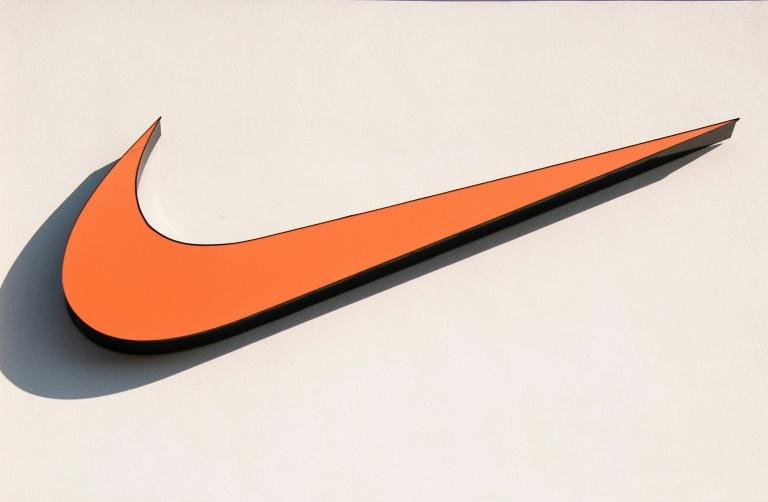 Nike shares fell after it reported a surprise loss following big sales declines in most major markets due to COVID-19 shutdowns