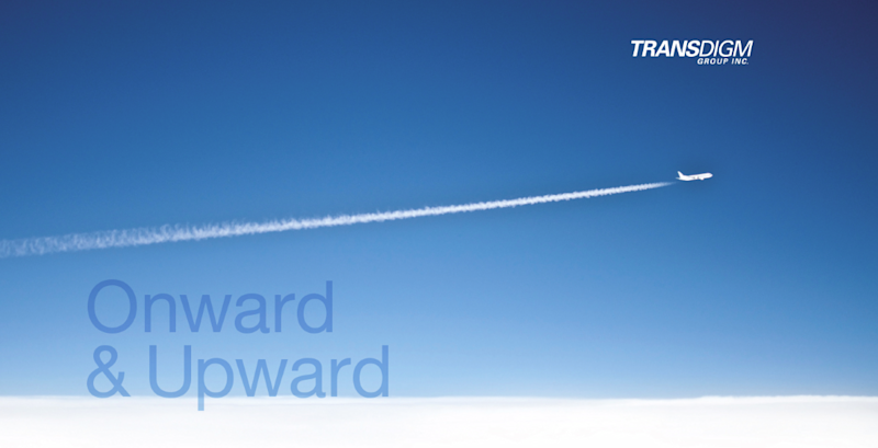 """Contrail behind a jet with slogan """"Onward & Upward"""" shown and the TransDigm logo in the corner"""