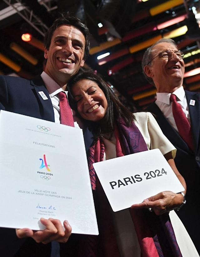 L-R: Paris 2024 Co-Chairman Tony Estanguet, Paris Mayor Anne Hidalgo and French National Olympic Committee president Denis Masseglia celebrate after Paris was awarded with the 2024 Olympic Games (AFP Photo/Martin BERNETTI)