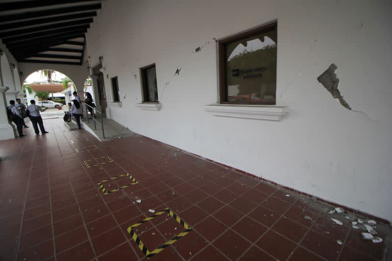 Cracks are seen on the wall of a hotel damaged by a quake in Huatulco