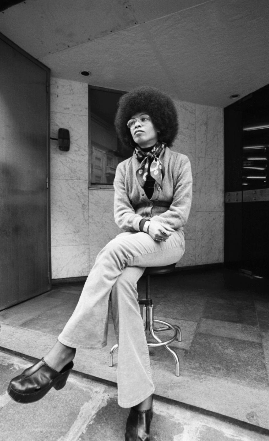 <p>Born in 1944 in Birmingham, Alabama, to schoolteacher parents, Angela Davis has been active in justice for Black prisoners from the sixties onward. Davis is currently a professor emerita at the University of California at Santa Cruz and has authored several books on race and politics, including <em>Women, Race & Class</em> and <em>Women, Culture, and Politics</em>. Here, she is photographed in May of 1975.</p>