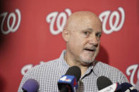 """FILE - In this Jan. 11, 2020, file photo, Washington Nationals general manager Mike Rizzo talks with members of the media during the team's """"Winterfest"""" baseball fan festival in Washington. The Nationals and Rizzo finalized a multiyear contract extension Saturday, Sept. 5, 2020. The 59-year-old Rizzo, who also holds the title of president of baseball operations, built the team that won the 2019 World Series championship. (AP Photo/Sait Serkan Gurbuz, File)"""
