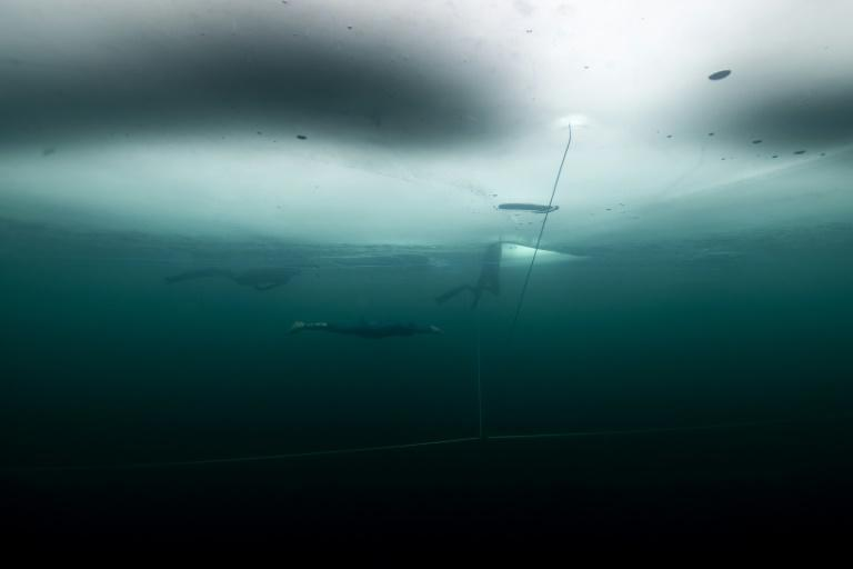 French freediver Arthur Guerin-Boeri swims on his way to a new world record of freediving under ice with wetsuit and no fins