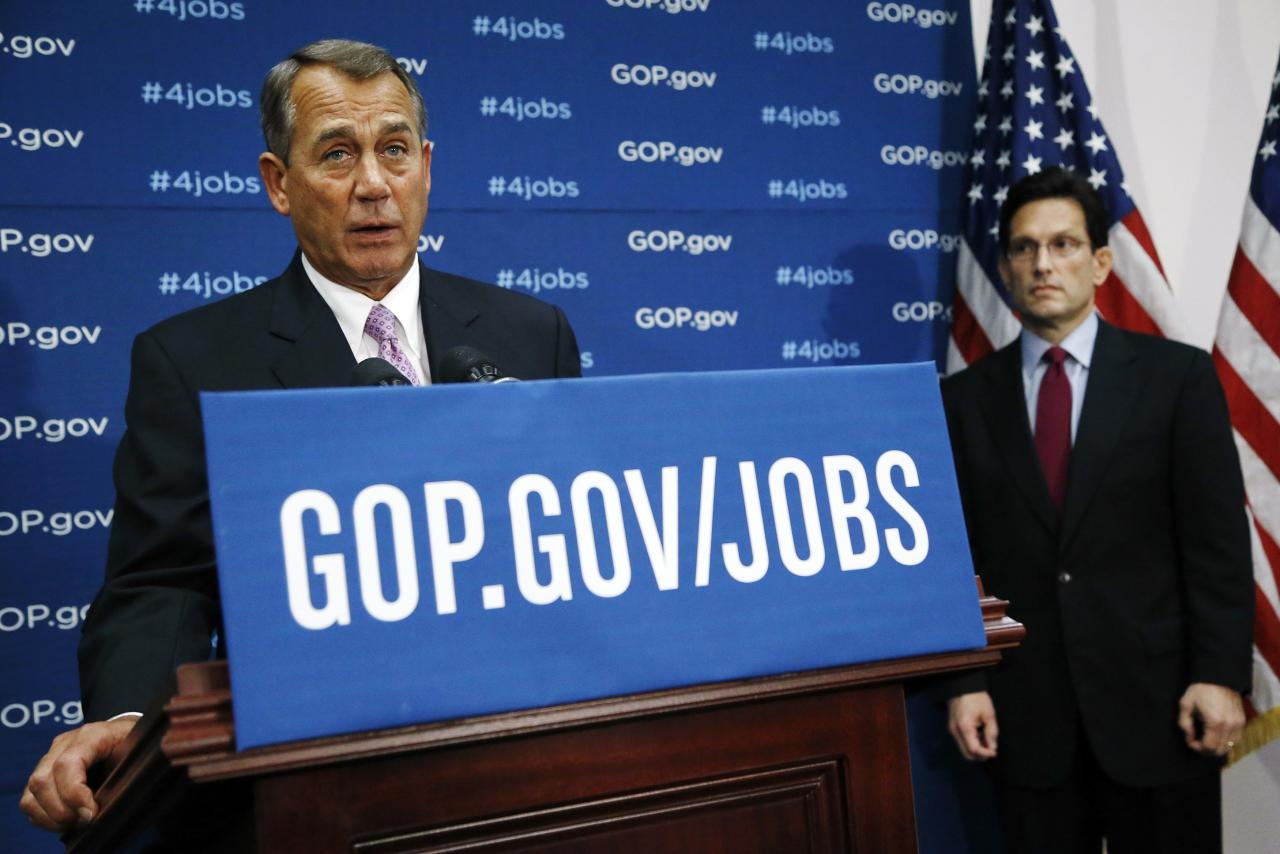 U.S. House Speaker John Boehner (R-OH) (L) is flanked by House Majority Leader Eric Cantor (R-VA) (R) as he holds a news conference after a House Republican caucus meeting at the U.S. Capitol in Washington, January 14, 2014. REUTERS/Jonathan Ernst (UNITED STATES - Tags: POLITICS)