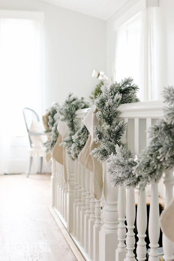"""<p>Bring the winter wonderland inside by wrapping flocked garland around the banister. To keep the color palette neutral and clean, stagger cream and white stockings. </p><p><em>See more at <a href=""""https://www.tidbits-cami.com/my-french-farmhouse-christmas-home-tour/"""" rel=""""nofollow noopener"""" target=""""_blank"""" data-ylk=""""slk:Tidbits"""" class=""""link rapid-noclick-resp"""">Tidbits</a>. </em></p><p><a class=""""link rapid-noclick-resp"""" href=""""https://www.amazon.com/CraftMore-Frosted-Forest-Pine-Garland/dp/B07F7NJ3L6/?tag=syn-yahoo-20&ascsubtag=%5Bartid%7C10072.g.34479907%5Bsrc%7Cyahoo-us"""" rel=""""nofollow noopener"""" target=""""_blank"""" data-ylk=""""slk:SHOP FLOCKED GARLAND"""">SHOP FLOCKED GARLAND</a></p>"""