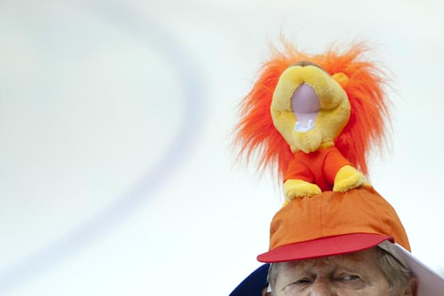 A Dutch fan arrives to watch the women's 3,000-meter speedskating race at the Adler Arena Skating Center during the 2014 Winter Olympics in Sochi, Russia, Sunday, Feb. 9, 2014. (AP Photo/Peter Dejong)