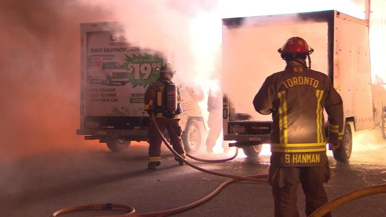 2 U-Haul trucks catch fire outside apartment building