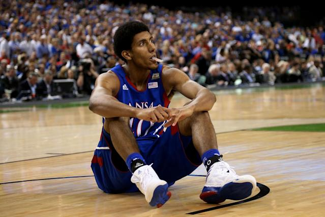 Kevin Young #40 of the Kansas Jayhawks looks on as he sits on the court in the second half against the Kentucky Wildcats in the National Championship Game of the 2012 NCAA Division I Men's Basketball Tournament at the Mercedes-Benz Superdome on April 2, 2012 in New Orleans, Louisiana. (Photo by Ronald Martinez/Getty Images)