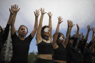 Women dressed in black perform to mourn those who have been killed, tortured and raped during an anti-government protest in Santiago, Chile, Friday, Nov. 1, 2019. Chile has been facing days of unrest, triggered by a relatively minor increase in subway fares. The protests have shaken a nation noted for economic stability over the past decades, which has seen steadily declining poverty despite persistent high rates of inequality. (AP Photo/Rodrigo Abd)