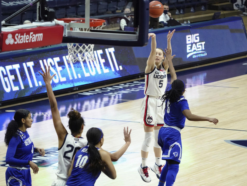 Connecticut guard Paige Bueckers (5) shoots against Seton Hall during the second half of an NCAA college basketball game Wednesday, Feb. 10, 2021, in Storrs, Conn. (David Butler II/Pool Photo via AP)