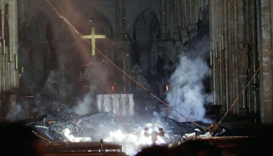 The cross behind the altar at Notre Dame remains intact (Picture: Reuters)