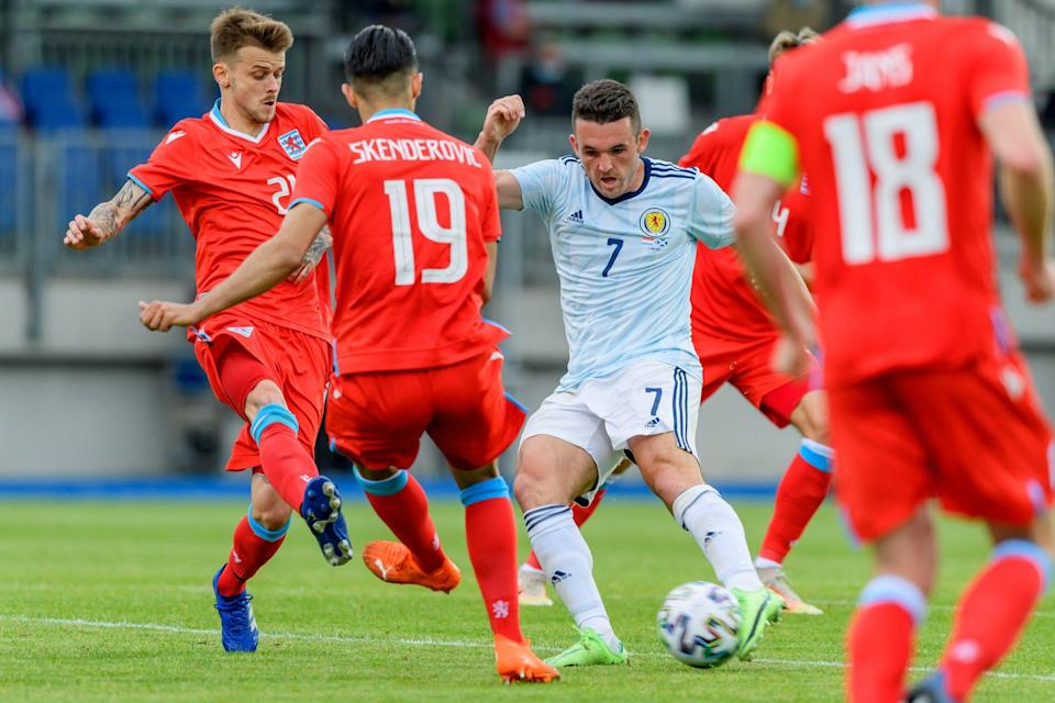 John McGinn is surrounded by Luxembourg players - GETTY IMAGES