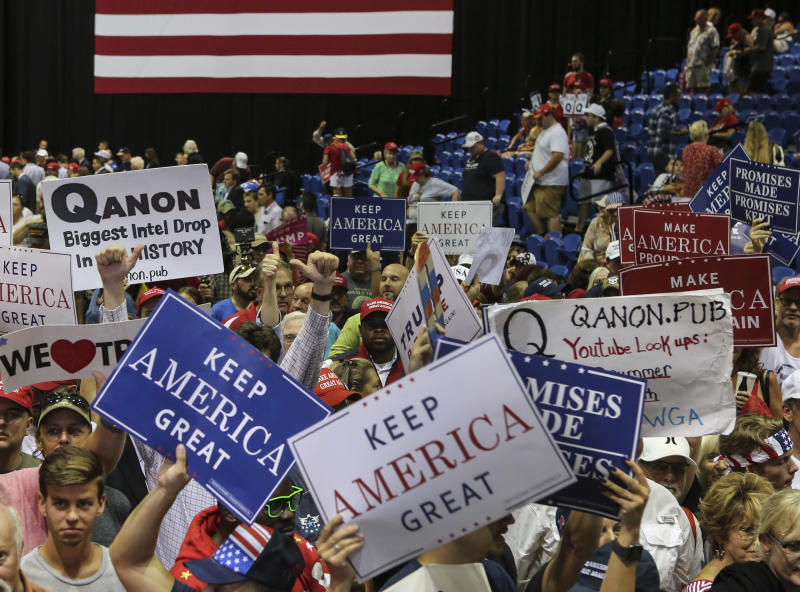 Trump supporters displaying QAnon posters appeared at President Donald J. Trumps Make America Great Again rally Tuesday, July 31, 2018 at the Florida State Fair Grounds in Tampa Florida. (Photo by Thomas O'Neill/NurPhoto via Getty Images)