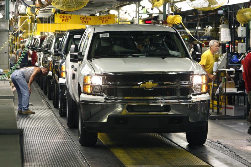 FILE-  In this June 23, 2010 file photo, 2011 Chevrolet Silverado's await final inspection at the Flint Assembly in Flint, Mich. General Motors Co. says strong demand for its pickups and wagons lifted October sales 3.5 percent and helped the automaker overcome weak car sales. (AP Photo/Carlos Osorio, FILE)