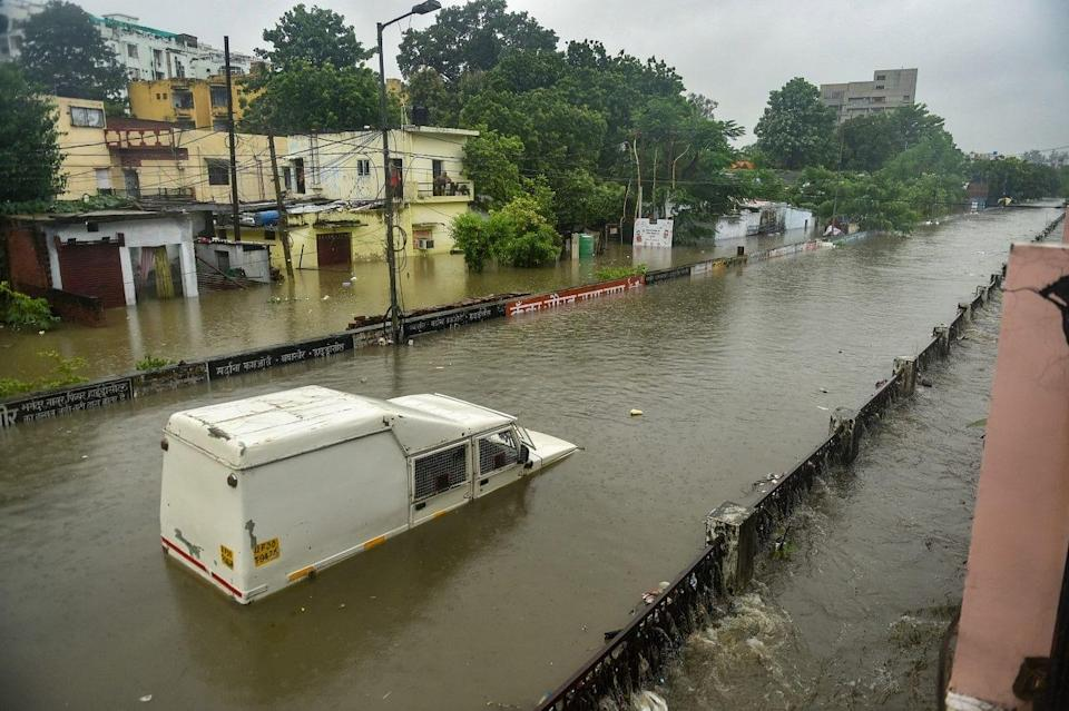 """<div class=""""paragraphs""""><p>A partially submerged vehicle due to waterlogging following heavy rains in Lucknow on Thursday, 16 September.</p></div>"""