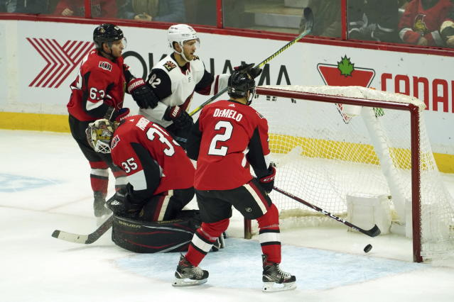 Arizona Coyotes defenseman Jordan Oesterle (82) scores on OttawaSenators goaltender Marcus Hogberg (35) during third-period NHL hockey game action in Ottawa, Ontario, Thursday, Feb. 13, 2020. (Chris Wattie/The Canadian Press via AP)