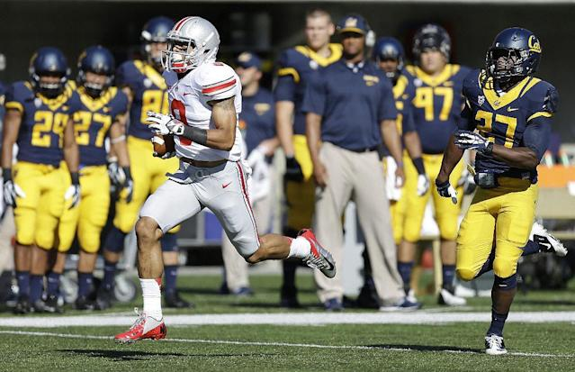 Ohio State's Devin Smith, left, outruns California's Damariay Drew (27) for a touchdown during the first quarter of an NCAA college football game, Saturday, Sept. 14, 2013, in Berkeley, Calif. (AP Photo/Ben Margot)