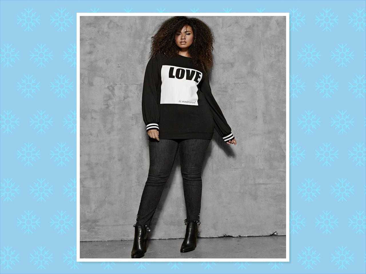 "<p>Nola x Jordyn Woods Crew Neck Sweater With Print, $58, <a rel=""nofollow"" href=""https://www.additionelle.com/en-us/nola-x-jordyn-woods-crew-neck-sweater-with-print/771220.html?cgid=Collections-Jordyn-Woods&dwvar_771220_color=Black"">Addition Elle</a> (Photo: Addition Elle) </p>"
