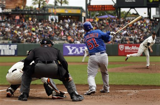 Chicago Cubs' Steve Clevenger (51) drives in a run with a single off San Francisco Giants starting pitcher Ryan Vogelsong, right, during the second inning of a baseball game in San Francisco, Monday, June 4, 2012. (AP Photo/Marcio Jose Sanchez)