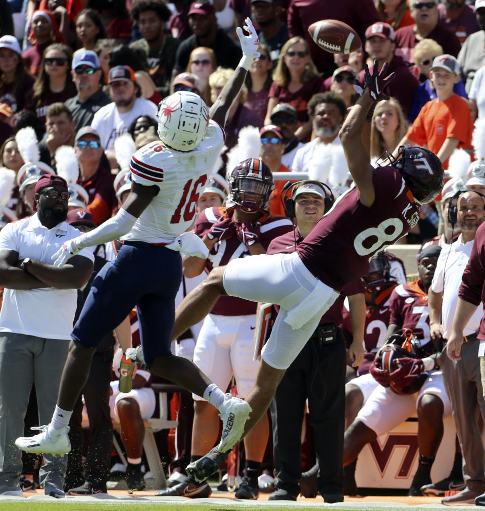 Virginia Tech wide receiver Kaleb Smith (80) attempts to catch a pass while guarded by Richmond's Aamir Hall (16) in the first half of the Richmond Virginia Tech NCAA college football game in Blacksburg, Va., Saturday, Sept. 25 2021. (Matt Gentry/The Roanoke Times via AP)