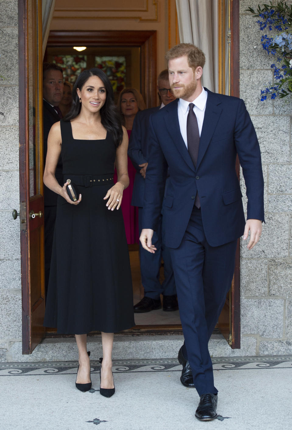 On July 10, Meghan changed into an Emilia Wickstead dress for a garden party at Glencairn House [Photo: Getty]
