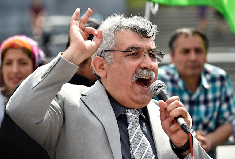 Zubeyir Aydar, president of the People's Congress of Kurdistan, addresses Kurdish protesters during a demonstration against alleged attacks perpetrated by the Turkish army against Kurds, August 8, 2015, in Brussels