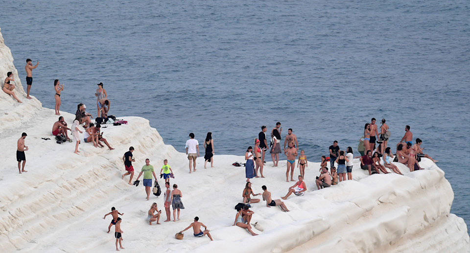Sicilians tried to escape the heat yesterday, on the coast of Realmonte, near Porto Empedocle. Source: AP / AAP