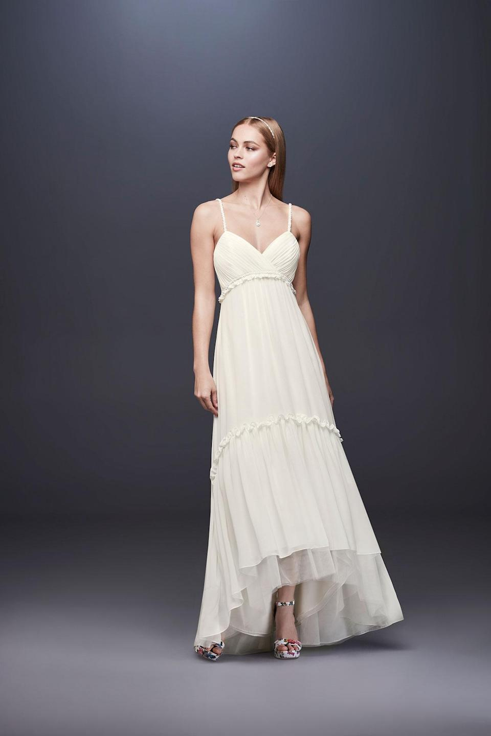 <p>A bohemian-style tiered dress. (Photo: Courtesy of David's Bridal) </p>