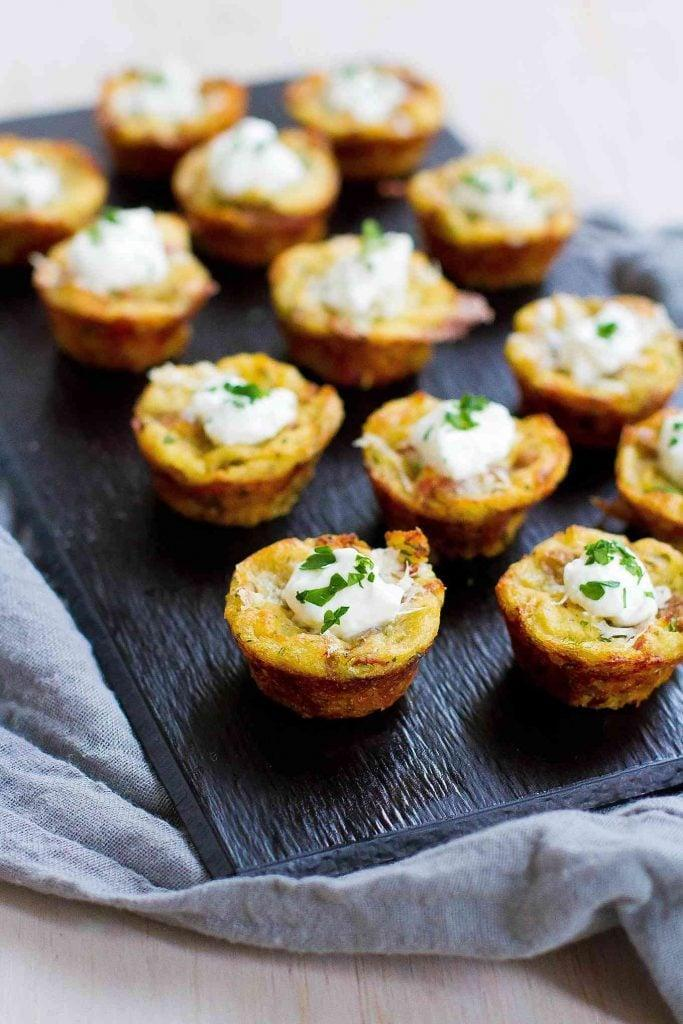 """<p>These bite-size snacks are rich and hearty. Add a dollop of sour cream on top to complete them. To adjust the serving size, all you have to do is tweak it on the website and it will automatically adjust. </p> <p><strong>Get the recipe:</strong> <a href=""""https://www.cookincanuck.com/baked-mashed-potato-bites-recipe/"""" class=""""link rapid-noclick-resp"""" rel=""""nofollow noopener"""" target=""""_blank"""" data-ylk=""""slk:baked mashed potato bites"""">baked mashed potato bites</a></p>"""