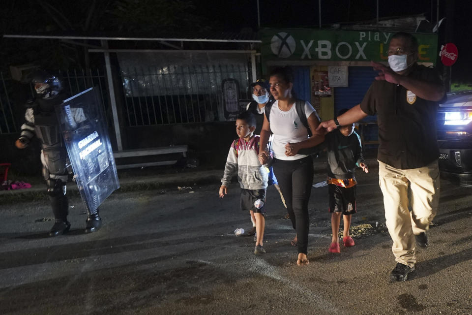 Mexican immigration agents detain Central American migrants who are part of a caravan heading north in Huixtla, Chiapas state, Mexico, Sunday, Sept. 5, 2021. (AP Photo/Marco Ugarte)