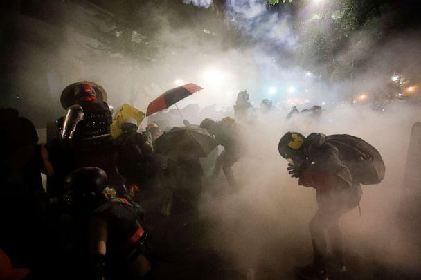 PHOTO: Federal officers launch tear gas at a group of demonstrators during a Black Lives Matter protest at the Mark O. Hatfield United States Courthouse, July 26, 2020, in Portland, Ore. (Marcio Jose Sanchez/AP)