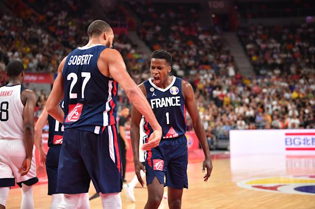 DONGGUAN, CHINA - SEPTEMBER 11: Frank Ntilikina #1 and Rudy Gobert #27 of Team France celebrates against the USA Basketball Men's National Team during the 2019 FIBA World Cup Quarter-Finals at the Dongguan Basketball Center on September 11, 2019 in Dongguan, China. (Photo by David Dow/NBAE via Getty Images)