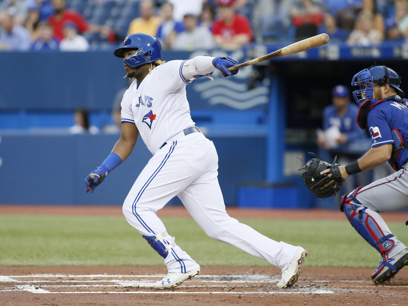 Aug 13, 2019; Toronto, Ontario, CAN; Toronto Blue Jays third baseman Vladimir Guerrero Jr. (27) singles against the Texas Rangers during the first inning at Rogers Centre. Mandatory Credit: John E. Sokolowski-USA TODAY Sports