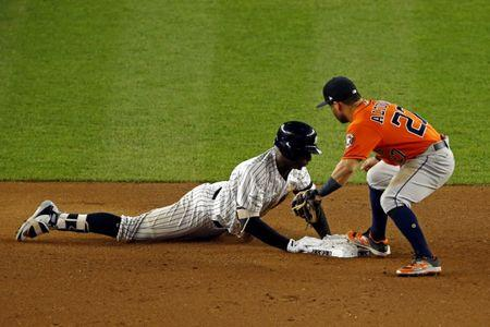 Oct 18, 2017; Bronx, NY, USA; New York Yankees shortstop Didi Gregorius (18) dives into second base for a double during the seventh inning against Houston Astros second baseman Jose Altuve (27) in game five of the 2017 ALCS playoff baseball series at Yankee Stadium. Mandatory Credit: Adam Hunger-USA TODAY Sports