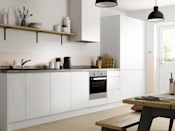"""<p>Simple and streamlined, white handleless cabinets are a must for the ultra minimalists. With a neutral palette of black and white, mixed with natural woods, and a small collection of Scandi accessories. </p><p>Pictured: <a href=""""https://www.benchmarxkitchens.co.uk/kitchens/madison-gloss-white-"""" rel=""""nofollow noopener"""" target=""""_blank"""" data-ylk=""""slk:Madison gloss white at Benchmarx"""" class=""""link rapid-noclick-resp"""">Madison gloss white at Benchmarx</a></p>"""