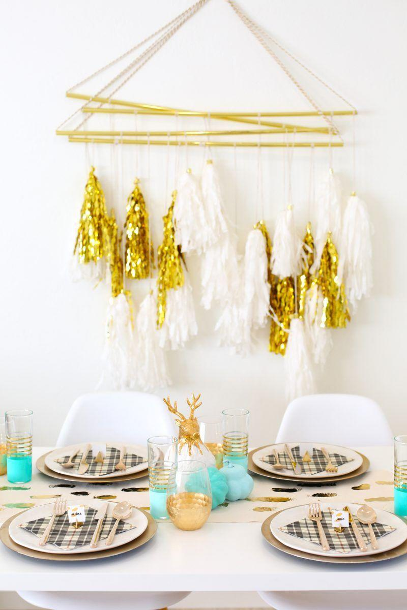 """<p>Do something unexpected this holiday season by dressing the dinner table in teal and gold. Give each table setting a Christmas feel with cozy plaid napkins and golden reindeer. </p><p><em><a href=""""https://lovelyindeed.com/diy-gold-foil-brushstroke-table-runner/"""" rel=""""nofollow noopener"""" target=""""_blank"""" data-ylk=""""slk:Get the tutorial at Lovely Indeed »"""" class=""""link rapid-noclick-resp"""">Get the tutorial at Lovely Indeed »</a></em></p>"""