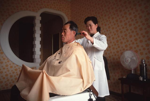 <p>A barber inside the 45-story Koryo Hotel in Pyongyang, North Korea. </p>