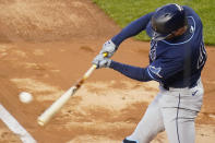 Tampa Bay Rays' Brandon Lowe hits a two-run double during the first inning of a baseball game against the New York Yankees on Friday, April 16, 2021, in New York. (AP Photo/Frank Franklin II)