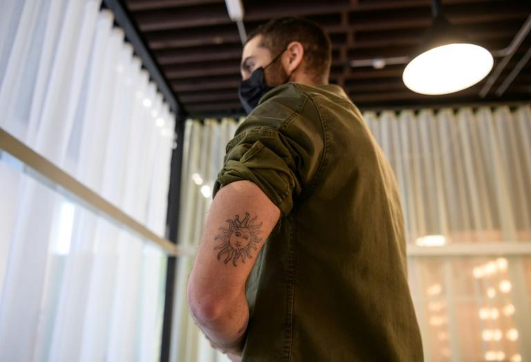 Josh Sakhai, one of the three co-founders of Ephemeral, shows off the temporary tattoos on his body