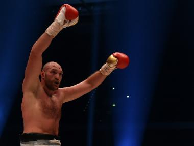 Tyson Fury overcomes bloody cut over eye to beat Otto Wallin and set up Deontay Wilder rematch