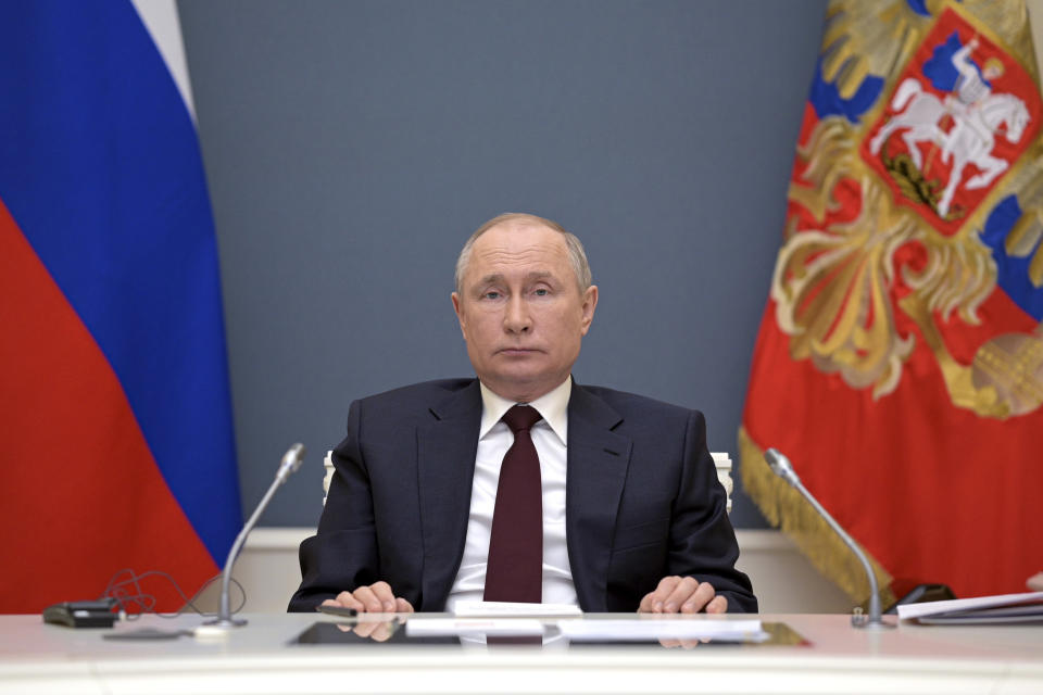 Russian President Vladimir Putin prepares to attend the virtual Leaders Summit on Climate in Moscow, Russia, Thursday, April 22, 2021. (Alexei Druzhinin, Sputnik, Kremlin Pool Photo via AP)