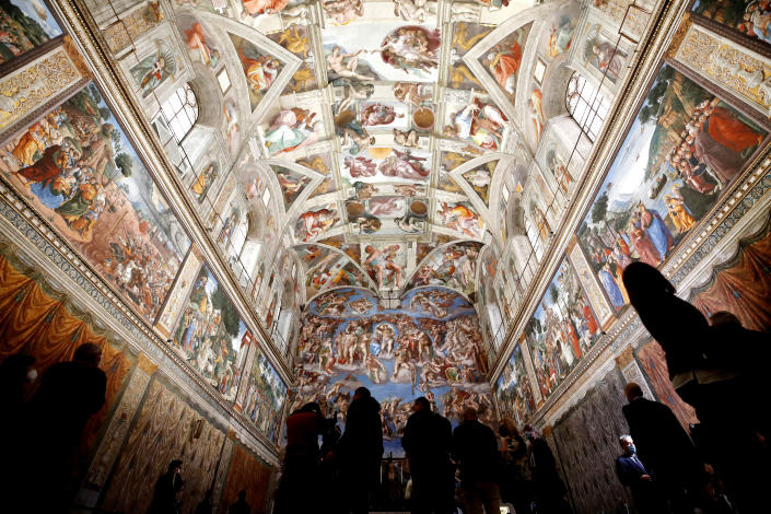 Visitors admire the Sistine Chapel of the Vatican Museums on the occasion of the museum's reopening, in Rome, Monday, May 3, 2021. The Vatican Museums reopened Monday to visitors after a shutdown following COVID-19 containment measures. (AP Photo/Alessandra Tarantino)