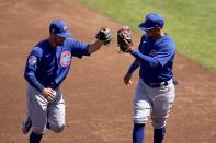 Chicago Cubs shortstop Eric Sogard, left, is congratulated by Cubs third baseman Ildemaro Vargas after Sogard's inning ending out against the Cleveland Indians during the second inning of a spring training baseball game Thursday, March 18, 2021, in Goodyear, Ariz. (AP Photo/Ross D. Franklin)