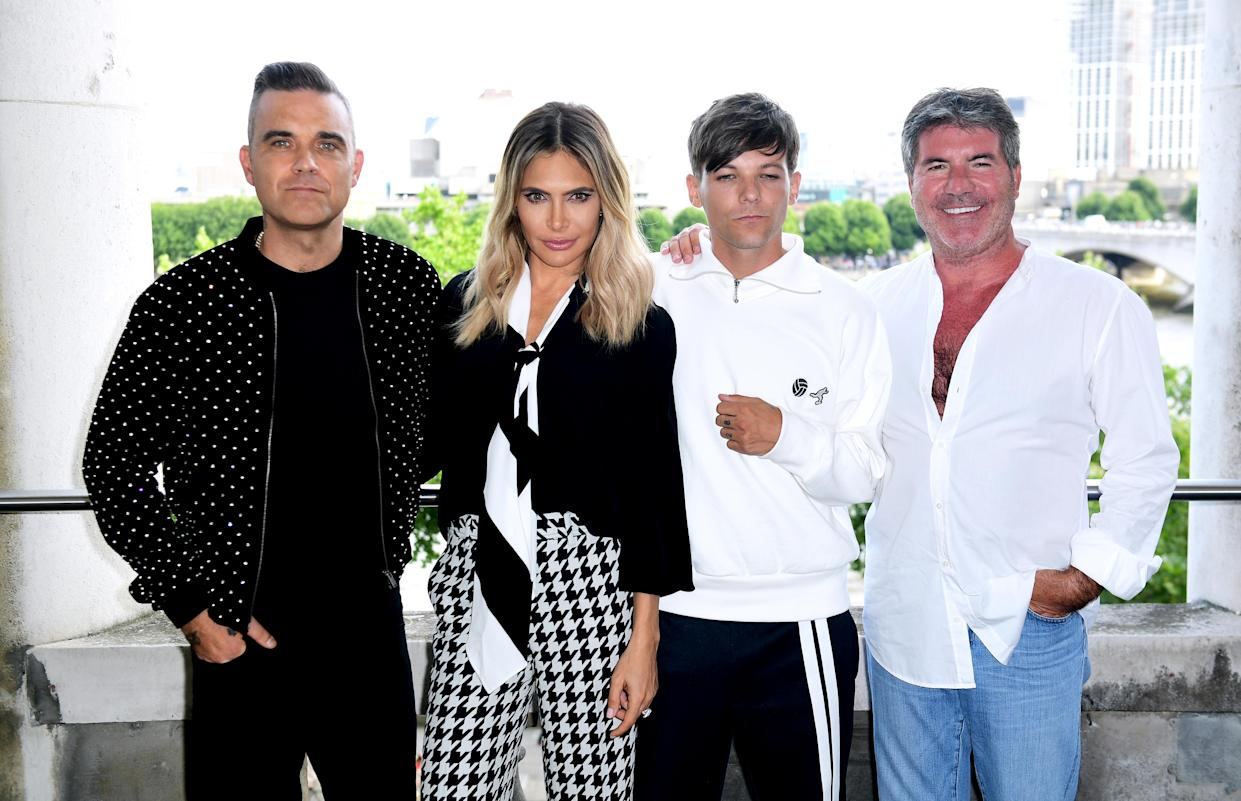 Last year's X Factor judging panel, Robbie Williams, Ayda Field, Louis Tomlinson and Simon Cowell (Ian West/PA)