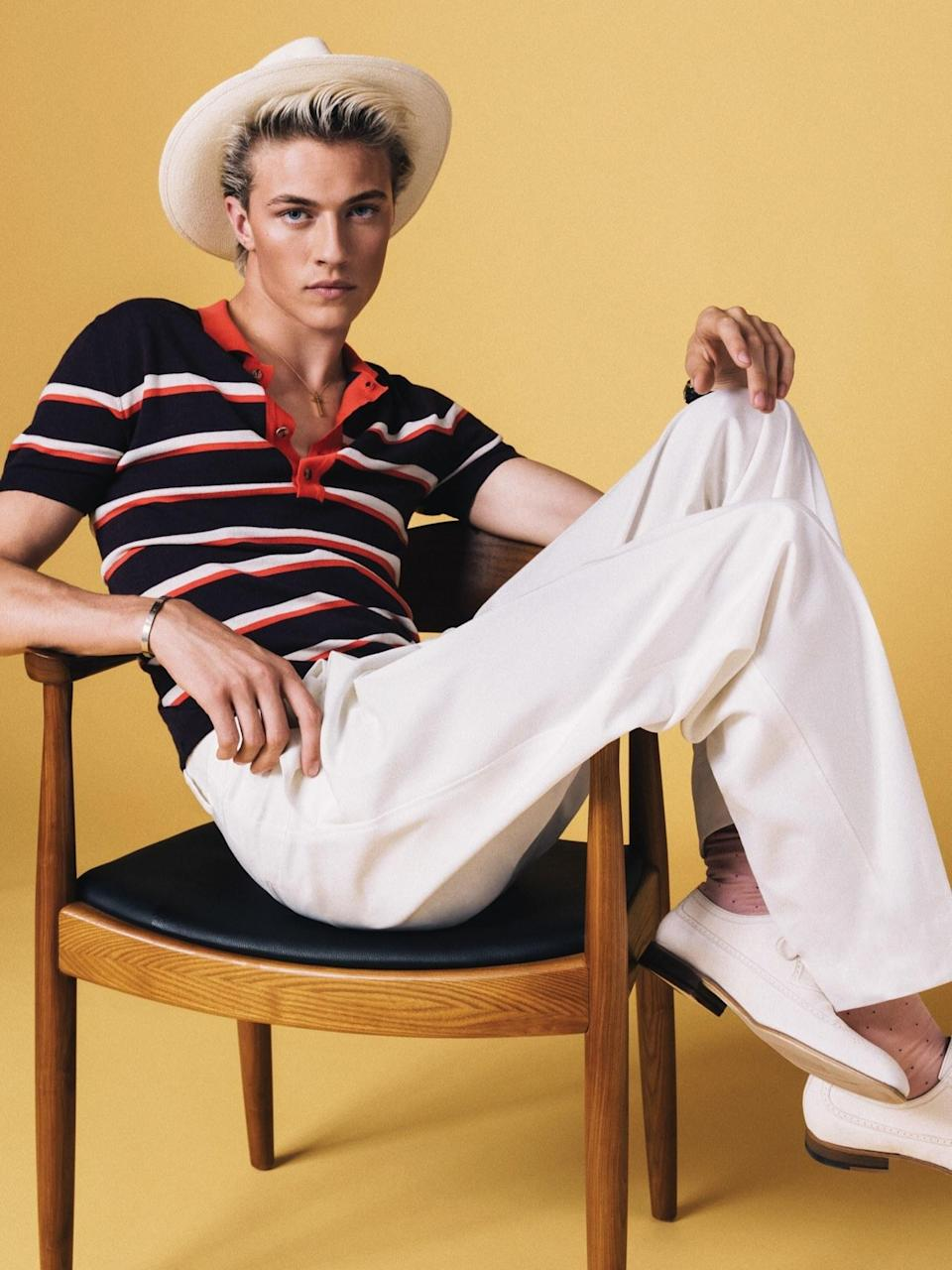 Try a pair of white dress trousers with the polo you were set to wear—instead of jeans—and wait for the compliments come rolling in.