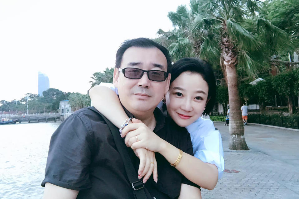 FILE - This undated, file photo released by Chongyi Feng shows Yang Hengjun and his wife Yuan Xiaoliang. Australia considers the incarceration of the Chinese-Australian writer who has been tried in Beijing for alleged espionage a case of arbitrary detention, the foreign minister said on Friday, May 28, 2021. Yang faced a closed trial on Thursday. The court deferred its verdict to a later date.(Chongyi Feng via AP, File)