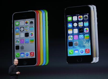 Apple Inc CEO Tim Cook speaks on stage during an Apple event in San Francisco