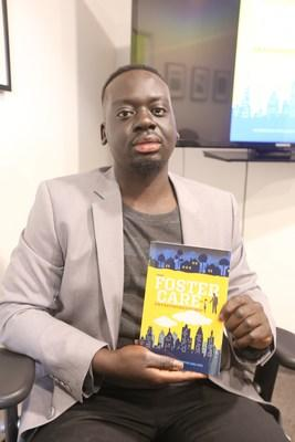 Lual Lual poses with his first published book.