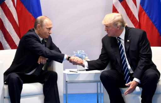<p>US President Donald Trump — shown here with Russia's President Vladimir Putin at the G20 summit in Germany in July — has long argued for better ties with Moscow </p>