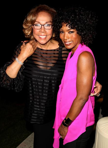 """Diahann Carol, left, and Angela Bassett pose together at the """"House of Flowers"""" dinner honoring Carol and AMPAS President Cheryl Boone Isaacs at the home of Tracey Edmonds on Saturday, Oct. 19, 2013 in Beverly Hills, Calif. (Photo by Matt Sayles/Invision/AP)"""
